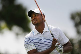 Tiger Woods watches his tee shot on the fifth hole during the first round of the Tour Championship golf tournament in Atlanta on Thursday, Sept. 20, 2012.  (AP Photo/John Bazemore)