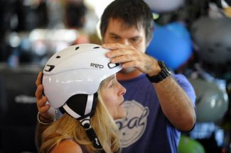 "AURORA, CO-- Alison Rochelle from Littleton gets a ""Red"" brand helmet fitted by sales rep., Matt Beck at the Colorado Ski and Golf in Aurora thursday afternoon during the Ski Rex VIP event Thursday afternoon. The annual sales event is open to the public on Saturday. Andy Cross, The Denver Post"