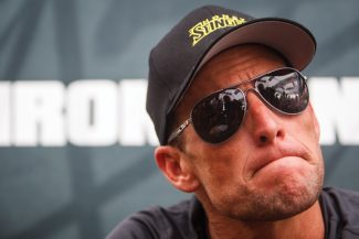FILE - This April 1, 2012 file photo shows seven-time Tour de France champion Lance Armstrong grimacing during a news conference after the Memorial Hermann Ironman 70.3 Texas triathlon in Galveston, Texas. The world may soon know what the U.S. Anti-Doping Agency has on Armstrong. USADA has said it had 10 former teammates ready to testify against Armstrong before he chose not to take his case to an arbitration hearing. The list likely includes previous Armstrong accusers Floyd Landis and Tyler Hamilton. (AP Photo/Houston Chronicle, Michael Paulsen, File ) MANDATORY CREDIT