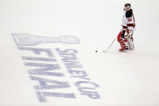 FILE - In this June 11, 2012, file photo, New Jersey Devils goalie Martin Brodeur skates towards center ice during a timeout in the second period against the Los Angeles Kings during Game 6 of NHL hockey's Stanley Cup finals in Los Angeles. The NHL announced Friday, Oct. 26, 2012, that it has canceled all its games through the end of November because of the labor dispute between owners and players.  (AP Photo/Jae C. Hong, File)