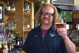 Special to the DailyDillon Dam Brewery brewmaster Cory Forster raises a glass of the French farmhouse-style ale known as 'bier de garde,' he brewed in honor of the Vincent Van Gogh exhibit at the Denver Museum of Art.