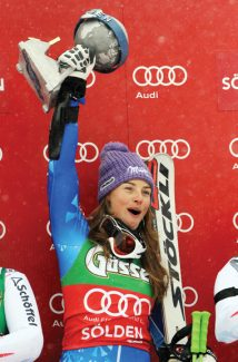 Slovenia's Tina Maze holds up her trophy on the podium after winning an alpine ski, women's World Cup giant slalom, in Soelden, Austria, Saturday, Oct. 27, 2012. (AP Photo/Alessandro Trovati)