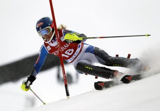 Mikaela Shiffrin, of the United States, negotiates a gate during the first run of an alpine ski, women's World Cup Slalom, in Levi, Finland, Saturday, Nov.10, 2012. (AP Photo/Shinichiro Tanaka)