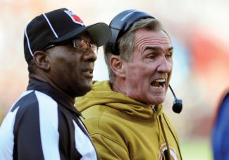 Washington Redskins coach Mike Shanahan, right, talks with an official during the first half of an NFL football game against the Carolina Panthers on Sunday, Nov. 4, 2012, in Landover, Md. (AP Photo/Nick Wass)