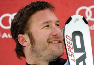 FILE - This Feb. 3, 2012 file photo shows Bode Miller smiling on the podium after finishing second in a World Cup downhill event in Chamonix, France. Whether it's in life or on the slopes, Olympic and world champion skier Miller charges after what he wants at a breathless speed. (AP Photo/Shinichiro Tanaka, File)