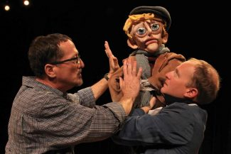 Photo: BLF PhotographyThis holiday season, the Backstage Theatre in Breckenridge presents a new adaptation of 'A Christmas Carol,' rendered with hand-constructed puppets and masks. Pictured: puppet creator Cory Gilstrap (left) and Tiny Tim puppeteer Josh Hartwell.