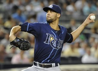 FILE - This Sept. 14, 2012 file photo shows Tampa Bay Rays starting pitcher David Price throwing against the New York Yankees in the first inning of a baseball game at Yankee Stadium in New York. Price and 2011 winner Justin Verlander are among the finalists for this year's AL Cy Young Award, Wednesday, Nov. 14, 2012.(AP Photo/Kathy Kmonicek, File)