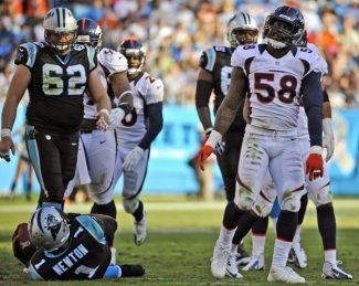 Denver Broncos' Von Miller (58) reacts after sacking Carolina Panthers' Cam Newton (1) during the second half of an NFL football game in Charlotte, N.C., Sunday, Nov. 11, 2012. (AP Photo/Rainier Ehrhardt)