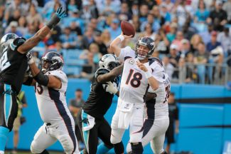 Denver Broncos' Peyton Manning (18) throws a pass against the Carolina Panthers during the first half of an NFL football game in Charlotte, N.C., Sunday, Nov. 11, 2012. (AP Photo/Mike McCarn)
