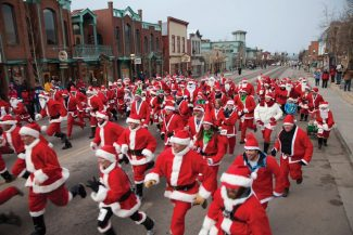 Special to the Daily/Nathan BilowOver 140 Santas took part in the first annual Race of the Santas on Main Street, Breckenridge, last year. This year, organizers added a Reindeer Run for kids.
