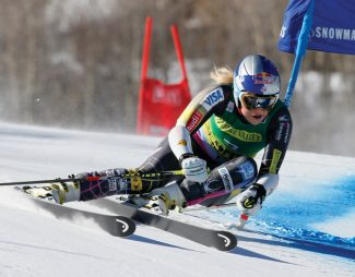 Lindsey Vonn of the United States, speeds down the course during the women's World Cup giant slalom ski race in Aspen, Colo., on Saturday, Nov. 24, 2012.  (AP Photo/ Nathan Bilow)