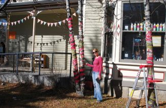 Special to the DailyPast window-decorating champion and owner of Magical Scraps MaryAnne Stecken has been known to take her displays beyond the boundaries of her window frame, decorating the whole front yard of her business.
