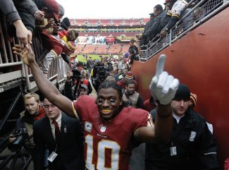 Washington Redskins quarterback Robert Griffin III (10) greets fans as he leaves the field after an NFL football game against the Philadelphia Eagles in Landover, Md., Sunday, Nov. 18, 2012. The Redskins defeated the Eagles 31-6. (AP Photo/Patrick Semansky)