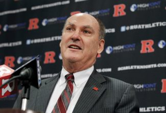 Big Ten Conference Commissioner Jim Delany answers a question during a news conference, Tuesday, Nov. 20, 2012, in Piscataway, N.J., after he and Rutgers Director of Intercollegiate Athletics Tim Pernetti  and Rutgers President Robert Barchi announced that Rutgers will join the Big Ten. Rutgers will join the conference in all sports at a date to be determined. (AP Photo/Mel Evans)