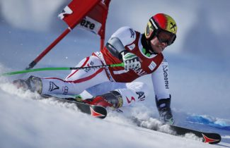 Austria's Marcel Hirscher speeds past a gate on his way to win an alpine ski, men's World Cup giant slalom in Val d'Isere, France, Sunday, Dec. 9, 2012. (AP Photo/Shinichiro Tanaka)