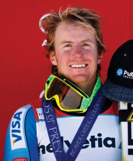 Ted Ligety smiles on the podium after winning at the men's World Cup giant slalom ski race in Beaver Creek, Colo, Sunday, Dec. 2, 2012. (AP Photo/Alessandro Trovati)