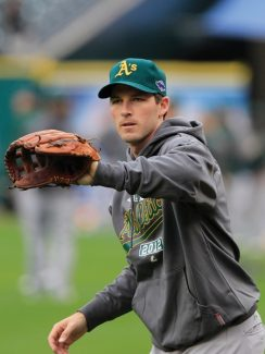 FILE - This Oct. 5, 2012 file photo shows Oakland Athletics shortstop Stephen Drew warming up during batting practice in preparation for Game 1 of the American League division baseball series against the Detroit Tigers, in Detroit. A person familiar with the negotiations tells The Associated Press that shortstop Drew and the Boston Red Sox have agreed to a $9.5 million, one-year contract. Drew will take a physical before the deal can be finalized, the person said Tuesday, Dec. 18, 2012, speaking on condition of anonymity because the agreement was not complete. (AP Photo/Carlos Osorio, File)