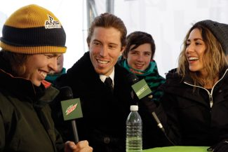 American snowboarders Kevin Pearce, left, and Shaun White joke with each other during a television interview for the Dew Tour at Breckenridge ski resort in Breckenridge, Colo., Friday, Dec. 14, 2012. As he heads into this weekend's Dew Tour iOn Mountain Championship finals, the opening event on the 2012-13 snowboarding calendar, White said there's more to come, with the Sochi Games just a little over a year away.  (AP Photo/Brennan Linsley)