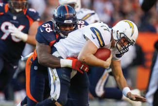 FILE - This Nov. 18, 2012 file photo shows Denver Broncos linebacker Von Miller (58) sacking San Diego Chargers quarterback Philip Rivers  (17) during an NFL game in Denver. The Broncos' linebacker is dominating games the way the Ravens' Ray Lewis  once did. (AP Photo/David Zalubowski, File)