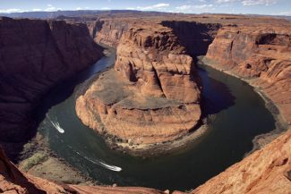 FILE - This March 5, 2008 file photo shows the Colorado River's Horseshoe Bend, in Page, Ariz. Rising demand and falling supply is spurring talk in the arid West of outside-the-box solutions like piping water from the nation's heartland and towing Arctic icebergs south to help thirsty U.S. cities like Denver, Los Angeles, Las Vegas and Phoenix that are currently dependent on the Colorado River. Faced with ongoing drought, federal officials and water agency representatives from seven states and 40 million people that depend on the Colorado River have produced a report to be released at a three-day Colorado River Water Users Association conference in Las Vegas. (AP Photo/Matt York, File)