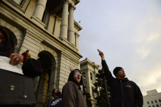 Daniel Henrickson holds up a marijuana cigarette as he waves to a helicopter on the steps of the State Capitol in Denver on Monday, Dec. 10, 2012. Marijuana for recreational use became legal in Colorado Monday, when the governor took a purposely low-key procedural step of declaring the voter-approved change part of the state constitution. (AP Photo/The Denver Post, AAron Ontiveroz) MAGS OUT; TV OUT; INTERNET OUT