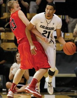 Colorado guard Andre Roberson, right, gets tangled up with Hartford forward Nate Sikma in the first half of an NCAA college basketball game in Boulder, Colo., on Saturday, Dec. 29, 2012. (AP Photo/David Zalubowski)