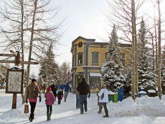Summit Daily/Jessica SmithThe streets of Breckenridge were even busy on Christmas Day. Snowy weather has had a positive effect on local businesses for the holidays.