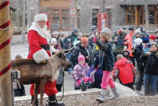 Summit Daily/Mark FoxSanta will make a return visit to Keystone's River Run Village this weekend, including during the day on Christmas Eve.