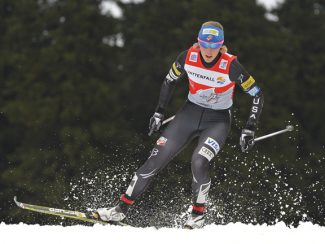 Fourteenth placed Kikkan Randall of the United States skis during the women's 9 km pursuit handicap race at the cross country Tour de Ski competition in Oberhof, Germany, Sunday, Dec. 30, 2012. (AP Photo/Jens Meyer)