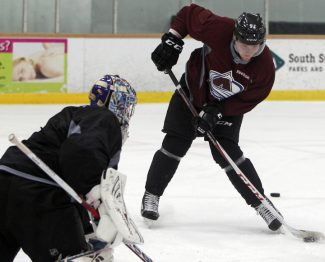 Colorado Avalanche left wing Gabriel Landeskog, right, of Sweden, directs his shot at goalie Semyon Varlaamov, of Russia, during the team NHL hockey practice session in Englewood, Colo., on Monday, Jan. 14, 2013. (AP Photo/David Zalubowski)