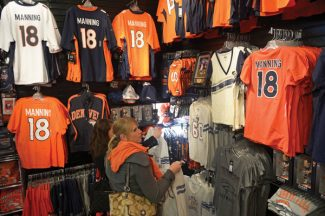 Ashley Lichtenberg, looks at some of the shirts available for sale at Where the Buffalo Roam. She was shopping on her lunch break with friend Lauren Bowie, next to Lauren at left.