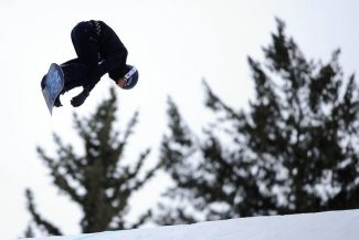 ASPEN, CO. - JANUARY 24: Shaun White grabs some air during the men's Snowboard Slopestyle elimination. Men's Snowboard Slopestyle elimination X Games Aspen Buttermilk Mountain Aspen January 24, 2013 (Photo By AAron Ontiveroz / The Denver Post)