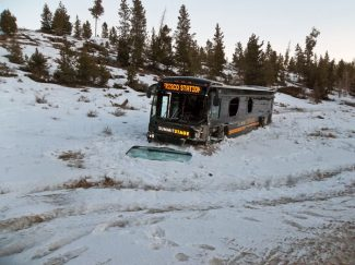 Special to the Daily/Summit StageOne of the new black Summit Stage buses suffered an estimated $80,000 in damage after it collided with an oncoming pickup truck that ran over the median early Tuesday morning on Highway 9 near Summit High School.