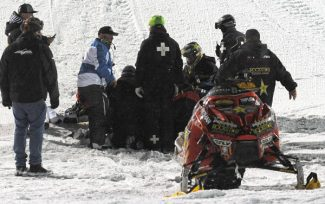 Emergency personnel tend to Caleb Moore Jan. 24, after he crashed during the snowmoblie freestyle event at the Winter X Games in Aspen. Moore died Thursday from complications following the crash.
