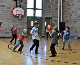 Special to the DailySilverthorne Elementary students practice their rugby skills after learning from Summit High rugby team member Astrid Ramos.