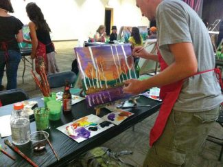 Special to the DailyAt Canvas & Cocktails, participants will follow an instructor's step-by-step instructions to create an acrylic painting of a retro-style owl. Canvas & Cocktails is a Cherry Creek-based business that brings the activity to Keystone for the local series.