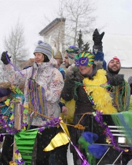 Summit Daily/Mark FoxPeople lined Main Street Breckenridge for the annual Fat Tuesday parade last year with hopes of catching beads tossed along the route.