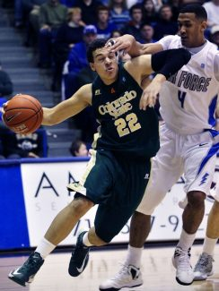 Colorado State's Dorian Green, left, moves the ball downcourt as Air Force's Kamryn Williams, right, covers him during the second half of an NCAA college basketball game in Air Force Academy, Colo., Saturday, Feb. 16, 2013. Colorado State won 89-86. (AP Photo/Brennan Linsley)