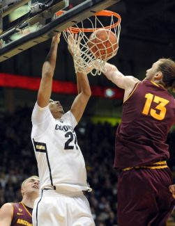 Colorado's Andre Roberson, left, dunks against Arizona State's Jordan Bachynski during the first half of an NCAA college basketball game on Saturday, Feb. 16, 2013, in Boulder, Colo. (AP Photo/Daily Camera, Cliff Grassmick)  NO SALES; MAGAZINES OUT
