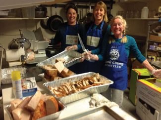 Special to the DailyTracy Cassard, Jean Radin and Rotarian Joni Bauer clearly enjoy cutting up the 140 lbs. of meat donated by City Market at a recent community dinner. The ladies prepared chicken, turkey and pork and served it with dressing made by Peter Hannishin and Marsha Harvey.