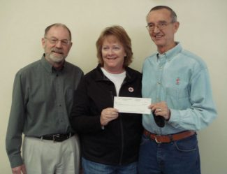 Special to the DailyPastor Joe Holub and Paul Hage from LOTM presented a check in the amount of $1,800 to Jody Acres, area manager for the American Red Cross. Included in the amount was $400 from Thrivent Financial for Lutherans.