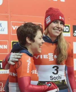 Winner Noelle Pikus-Pace, right, and second placed Katie Uhlaender, left, both of the U.S. celebrate on the podium  after the finish in the women's Bob event at the FIBT Bob & Skeleton World Cup 2013, in Krasnaya Polyana resort, some 60 km east of Sochi, Russia, Saturday, Feb. 16, 2013. (AP Photo/Mikhail Metzel)