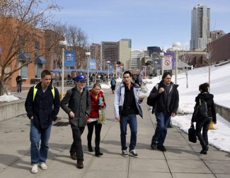 This Feb. 28, 2013 photo shows students walking the campus at Metropolitan State University in Denver. A bill being considered by the Colorado Senate would ban concealed carry of firearms on public college campuses. (AP Photo/Ed Andrieski)