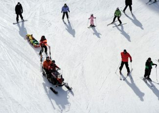 SUMMIT COUNTY, CO. - MARCH 2ND: Breckenridge Ski Patrollers take an injured skier off the a hill  at the Breckenridge Ski Area Saturday, March 2nd, 2013.  (Photo By Andy Cross/The Denver Post)