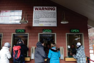 SUMMIT COUNTY, CO. - MARCH 2ND: A warning sign greets Keystone Ski Resort skiers and snow riders at the ticket office reminding them that they assume the risk of injury by Colorado law, when skiing and snow riding at Keystone Saturday, March 2nd, 2013. The sign is highly visible throughout all Colorado ski areas. (Photo By Andy Cross/The Denver Post)