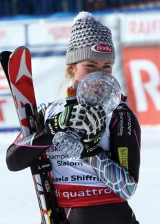 Mikaela Shiffrin from the United States kisses the women's slalom overall standing trophy during Alpine Ski World Cup final in Lenzerheide, Switzerland, Saturday, March 16, 2013. (AP Photo/Armando Trovati)
