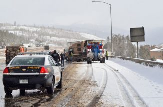 Summit Daily News / Caddie Nath A semi truck jack-knifed on Interstate 70 eastbound Tuesday morning. Authorities had reduced traffic to a single lane around the wreck as clean up efforts continued.