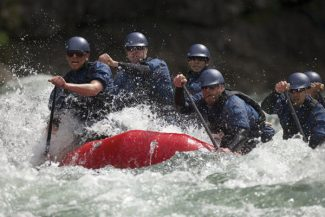 Special to the DailyFrom left: Jeremiah Peck, Kurt Myers, John Anicito, Matt Norfleet and Matt Kopp, of the Ark Sharks, paddle Oregon's whitewater in May 2011. This year the team is taking its first stab at the national competition.