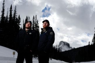 WALDEN, CO - MARCH 27: Sam McCloskey and Andrew Maddox pose for a portrait at the site of a recent avalanche rescue just off of Cameron Pass on Highway 14 between Walden and Fort Collins. Alex White was buried for three hours earlier this month. He survived the slide after McCloskey and Maddox rode treacherous terrain on snowmobiles to uncover him. (Photo by AAron Ontiveroz/The Denver Post)