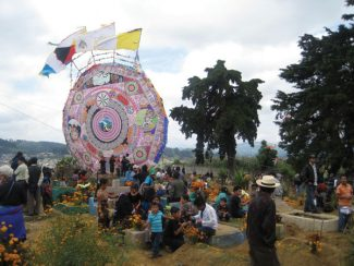 Special to the Daily/Carolyn SchwartzGiant circular kites take center stage during Santiago's joyful Day of the Dead festivities.